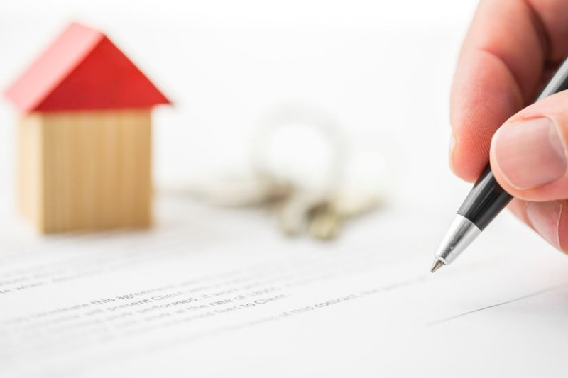 firmar el contrato en real estate